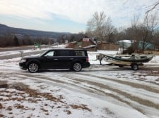 flex towing boat in snow